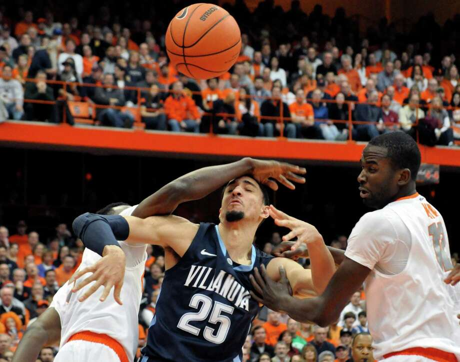 Villanova's Maurice Sutton battles Syracuse's Jerami Grant, left, and Baye Moussa Keita for a loose ball during the first half of an NCAA college basketball game in Syracuse, N.Y., Saturday, Jan. 12, 2013. (AP Photo/Kevin Rivoli) Photo: KEVIN RIVOLI