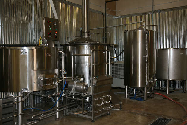 Kettles at the Branchline Brewing Company. From left to right are the mash tun, boil kettle, and a bright tank (a tank for clarifying beer after fermentation).