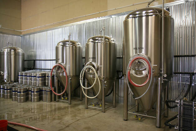 Three fermentation tanks at Branchline Brewing Company. The left two hold 10 barrels (310 gallons), and the one on the right holds 20 barrels. They plan to add at least two more tanks soon to increase capacity.