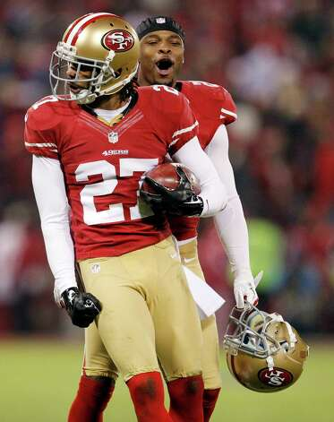 San Francisco 49ers safety C.J. Spillman (27) celebrates after recovering a fumble by Green Bay Packers wide receiver Jeremy Ross (10) with defensive back Perrish Cox (20) during the second quarter of an NFC divisional playoff NFL football game in San Francisco, Saturday, Jan. 12, 2013. (AP Photo/Tony Avelar) Photo: Tony Avelar, Associated Press / FR155217 AP