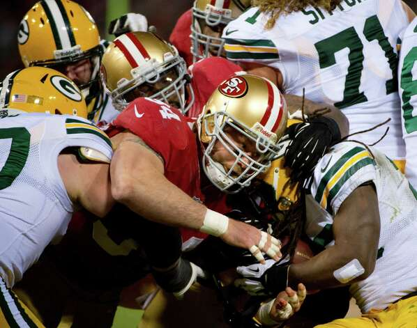 San Francisco 49ers Justin Smith stops Green Bay Packers DuJuan Harris in the second quarter of an NFC divisional playoff NFL football game on Saturday, Jan. 12, 2013, in San Francisco. (AP Photo/The Sacramento Bee, Jose Luis Villegas) Photo: Jose Luis Villegas, Associated Press / The Sacramento Bee