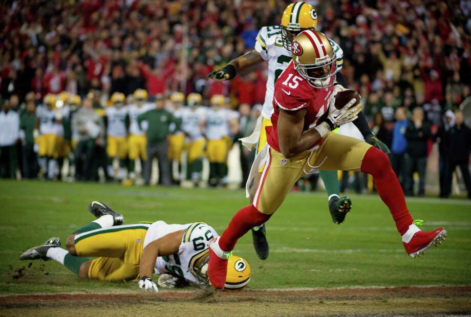San Francisco 49ers' Michael Crabtree drives past Green Bay Packers' Brad Jones for a touchdown in the second quarter of an NFC divisional playoff NFL football game on Saturday, Jan. 12, 2013, in San Francisco. (AP Photo/The Sacramento Bee, Jose Luis Villegas) Photo: Jose Luis Villegas, Associated Press / The Sacramento Bee