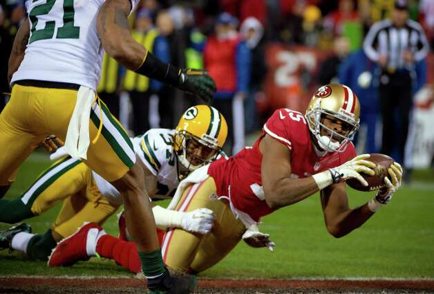 San Francisco 49ers' Michael Crabtree dives into the end zone for a touchdown under pressure from Green Bay Packers San Shields during the second quarter of during an NFC divisional playoff NFL football game on Saturday, Jan. 12, 2013, in San Francisco. (AP Photo/The Sacramento Bee, Jose Luis Villegas) Photo: Jose Luis Villegas, Associated Press / The Sacramento Bee