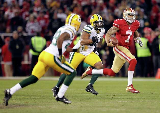 San Francisco 49ers quarterback Colin Kaepernick (7) runs from Green Bay Packers defensive tackle Mike Neal (96) and cornerback Casey Hayward (29) during the second quarter of an NFC divisional playoff NFL football game in San Francisco, Saturday, Jan. 12, 2013. (AP Photo/Tony Avelar) Photo: Tony Avelar, Associated Press / FR155217 AP