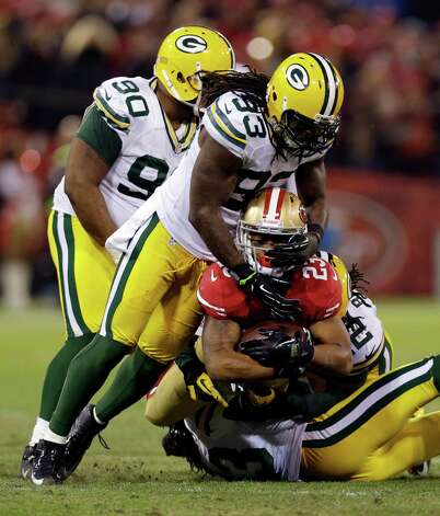 San Francisco 49ers running back LaMichael James (23) is tackled by Green Bay Packers outside linebacker Erik Walden (93), strong safety Morgan Burnett (42) and free safety M.D. Jennings during the second quarter of an NFC divisional playoff NFL football game in San Francisco, Saturday, Jan. 12, 2013. (AP Photo/Marcio Jose Sanchez) Photo: Marcio Jose Sanchez, Associated Press / AP