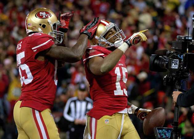 San Francisco 49ers' Michael Crabtree is congratulated by teammate Vernon Davis after scoring a touchdown in the second quarter of an NFC divisional playoff NFL football game against the Green Bay Packers on Saturday, Jan. 12, 2013, in San Francisco. (AP Photo/The Sacramento Bee, Jose Luis Villegas) Photo: Jose Luis Villegas, Associated Press / The Sacramento Bee