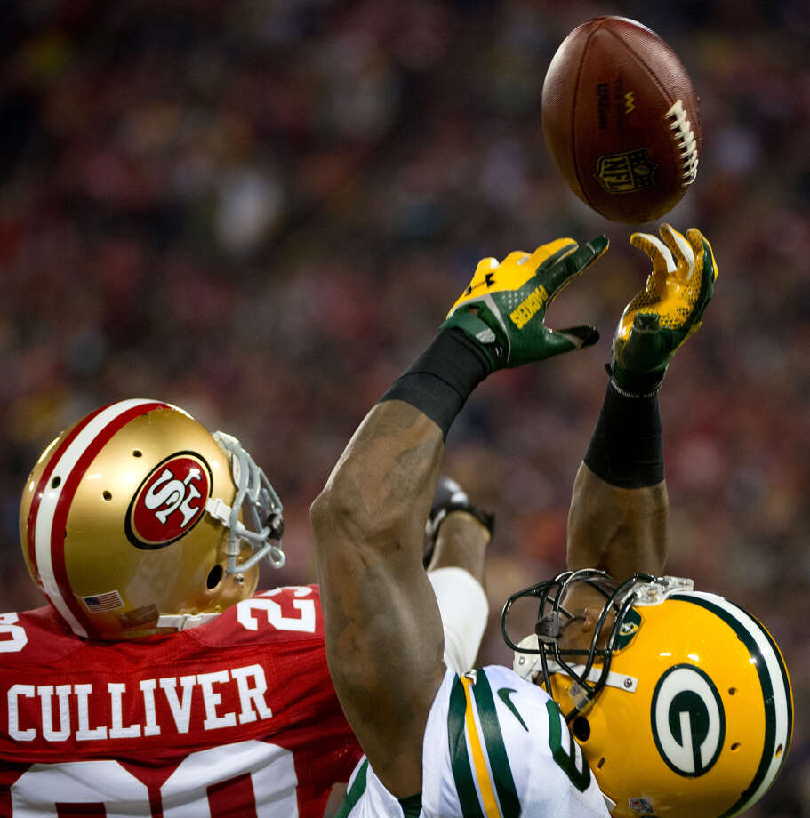 Green Bay Packers' James Jones catches a pass from quarterback Aaron Rodgers against San Francisco 49ers' Chris Culliver during the first quarter of an NFC divisional playoff NFL football game on Saturday, Jan. 12, 2013, in San Francisco. (AP Photo/The Sacramento Bee, Jose Luis Villegas) Photo: Jose Luis Villegas, Associated Press / The Sacramento Bee