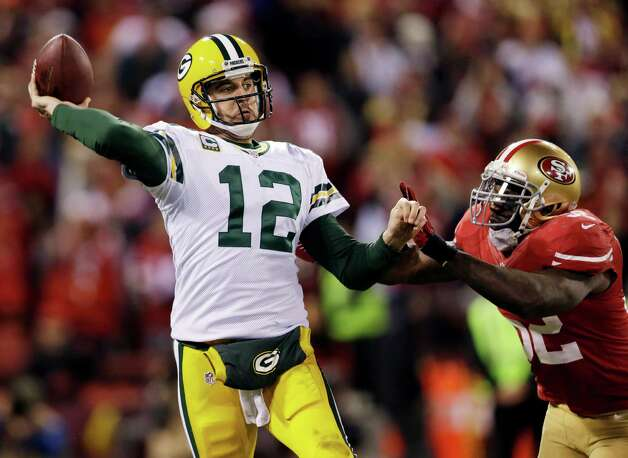 Green Bay Packers quarterback Aaron Rodgers (12) is pressured by San Francisco 49ers linebacker Patrick Willis (52) during the third quarter of an NFC divisional playoff NFL football game in San Francisco, Saturday, Jan. 12, 2013. (AP Photo/Marcio Jose Sanchez) Photo: Marcio Jose Sanchez, Associated Press / AP