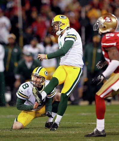 Green Bay Packers kicker Mason Crosby (2) kicks a 31-yard field goal during the third quarter of an NFC divisional playoff NFL football game against the San Francisco 49ers in San Francisco, Saturday, Jan. 12, 2013. (AP Photo/Tony Avelar) Photo: Tony Avelar, Associated Press / FR155217 AP