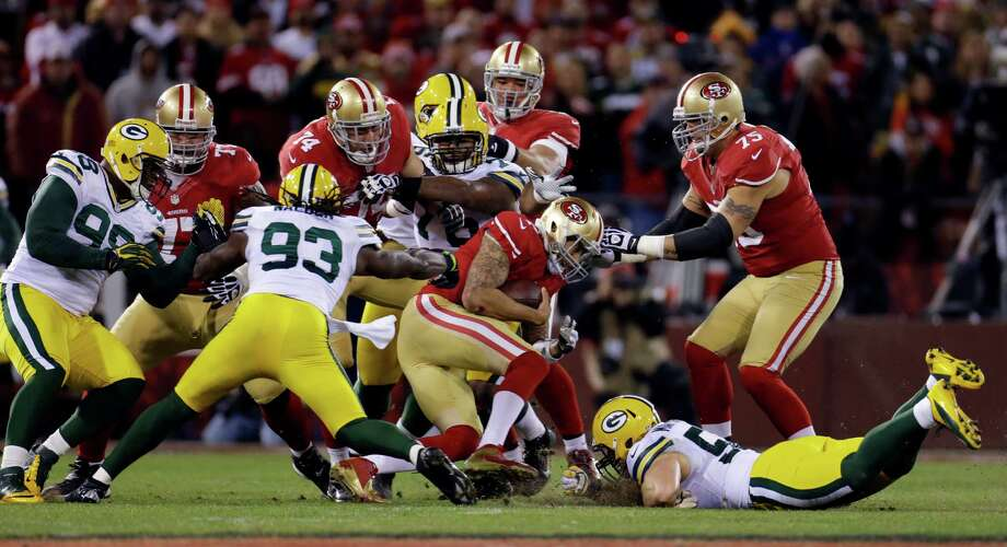 San Francisco 49ers quarterback Colin Kaepernick (7) is tackled by Green Bay Packers outside linebacker Erik Walden (93) and outside linebacker Clay Matthews (52) during the first quarter of an NFC divisional playoff NFL football game in San Francisco, Saturday, Jan. 12, 2013. (AP Photo/Ben Margot) Photo: Ben Margot, Associated Press / AP