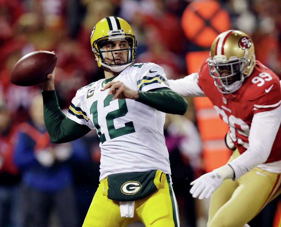 Green Bay Packers quarterback Aaron Rodgers (12) throws against the San Francisco 49ers during the second quarter of an NFC divisional playoff NFL football game in San Francisco, Saturday, Jan. 12, 2013. (AP Photo/Marcio Jose Sanchez) Photo: Marcio Jose Sanchez, Associated Press / AP