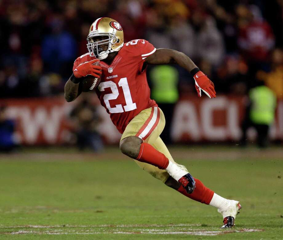 San Francisco 49ers running back Frank Gore (21) runs against the Green Bay Packers during the fourth quarter of an NFC divisional playoff NFL football game in San Francisco, Saturday, Jan. 12, 2013. (AP Photo/Marcio Jose Sanchez) Photo: Marcio Jose Sanchez, Associated Press / AP