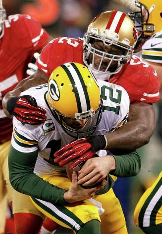 San Francisco 49ers linebacker Patrick Willis (52) sacks Green Bay Packers quarterback Aaron Rodgers (12) during the third quarter of an NFC divisional playoff NFL football game in San Francisco, Saturday, Jan. 12, 2013. (AP Photo/Tony Avelar) Photo: Tony Avelar, Associated Press / FR155217 AP