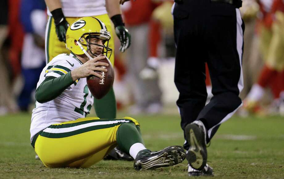 Green Bay Packers quarterback Aaron Rodgers (12) sits on the ground during the second half of an NFC divisional playoff NFL football game against the San Francisco 49ers in San Francisco, Saturday, Jan. 12, 2013. (AP Photo/Ben Margot) Photo: Ben Margot, Associated Press / AP