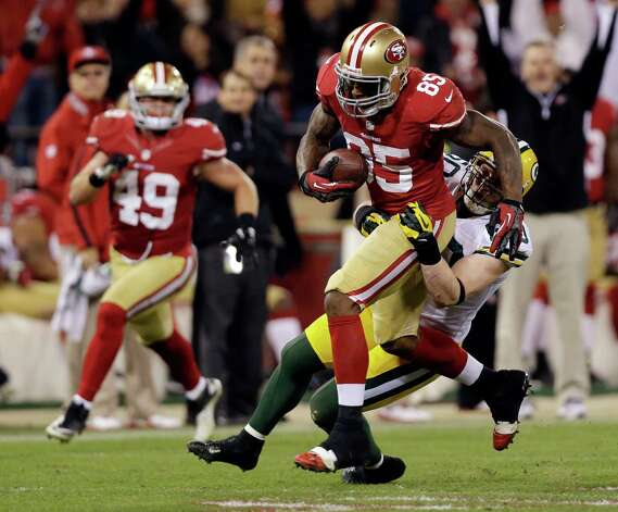 San Francisco 49ers tight end Vernon Davis (85) is tackled by Green Bay Packers inside linebacker A.J. Hawk (50) during the third quarter of an NFC divisional playoff NFL football game in San Francisco, Saturday, Jan. 12, 2013. (AP Photo/Marcio Jose Sanchez) Photo: Marcio Jose Sanchez, Associated Press / AP
