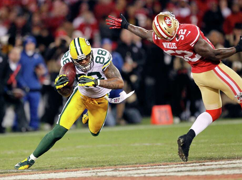 Green Bay Packers tight end Jermichael Finley (88) catches a pass against San Francisco 49ers linebacker Patrick Willis (52) during the second quarter of an NFC divisional playoff NFL football game in San Francisco, Saturday, Jan. 12, 2013. (AP Photo/Tony Avelar) Photo: Tony Avelar, Associated Press / FR155217 AP