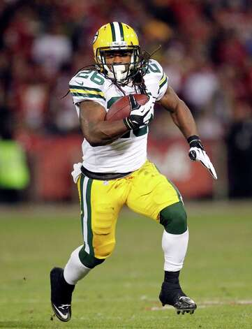 Green Bay Packers running back DuJuan Harris (26) carries the ball against the San Francisco 49ers during the second quarter of an NFC divisional playoff NFL football game in San Francisco, Saturday, Jan. 12, 2013. (AP Photo/Tony Avelar) Photo: Tony Avelar, Associated Press / FR155217 AP