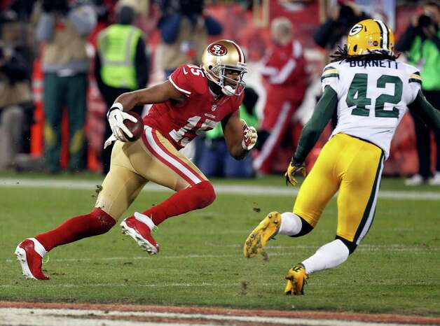 San Francisco 49ers wide receiver Michael Crabtree (15) carries the ball past Green Bay Packers strong safety Morgan Burnett (42) during the first half of an NFC divisional playoff NFL football game in San Francisco, Saturday, Jan. 12, 2013. (AP Photo/Tony Avelar) Photo: Tony Avelar, Associated Press / FR155217 AP