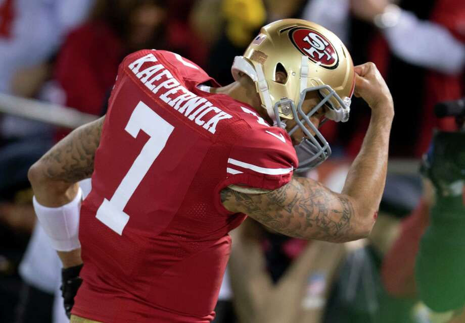 San Francisco 49ers quarterback Colin Kaepernick (7) celebrates his touchdown against the Green Bay Packers during an NFC divisional playoff NFL football game on Saturday, Jan. 12, 2013, in San Francisco. (AP Photo/The Sacramento Bee, Hector Amezcua) Photo: Hector Amezcua, Associated Press / The Sacramento Bee