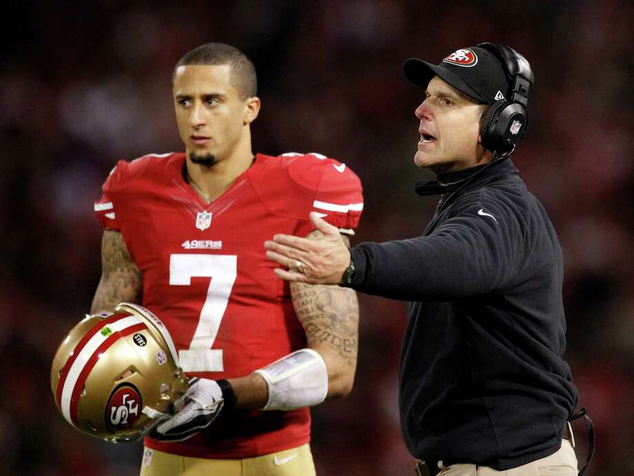 San Francisco 49ers head coach Jim Harbaugh gestures next to quarterback Colin Kaepernick (7) against the Green Bay Packers during the second half of an NFC divisional playoff NFL football game in San Francisco, Saturday, Jan. 12, 2013. (AP Photo/Tony Avelar) Photo: Tony Avelar, Associated Press / FR155217 AP
