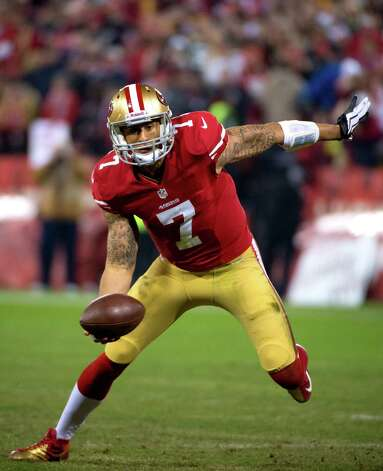 San Francisco 49ers quarterback Colin Kaepernick picks up a fumble for a loss in the second quarter during an NFC divisional playoff NFL football game against the Green Bay Packers on Saturday, Jan. 12, 2013, in San Francisco. (AP Photo/The Sacramento Bee, Jose Luis Villegas) Photo: Jose Luis Villegas, Associated Press / The Sacramento Bee