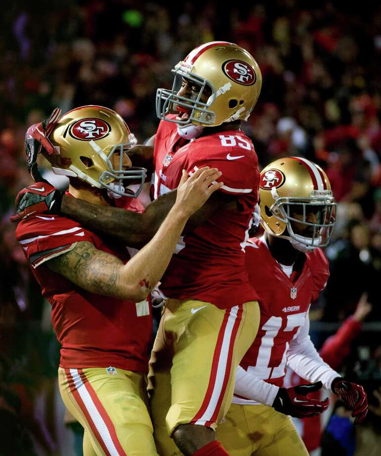 San Francisco 49ers quarterback Colin Kaepernick and teammate Vernon Davis celebrate Kaepernick's touchdown in the first quarter of an NFC divisional playoff NFL football game against the Green Bay Packers on Saturday, Jan. 12, 2013, in San Francisco. (AP Photo/The Sacramento Bee, Jose Luis Villegas) Photo: Jose Luis Villegas, Associated Press / The Sacramento Bee
