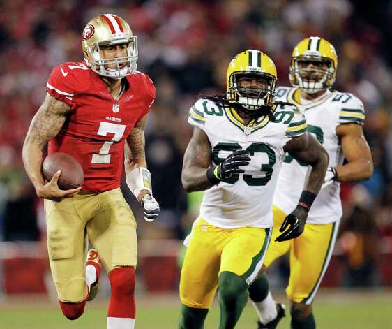 San Francisco 49ers quarterback Colin Kaepernick (7) runs for a 56-yard touchdown past Green Bay Packers outside linebacker Erik Walden (93) and inside linebacker Brad Jones (59) during the third quarter of an NFC divisional playoff NFL football game in San Francisco, Saturday, Jan. 12, 2013. (AP Photo/Tony Avelar) Photo: Tony Avelar, Associated Press / FR155217 AP