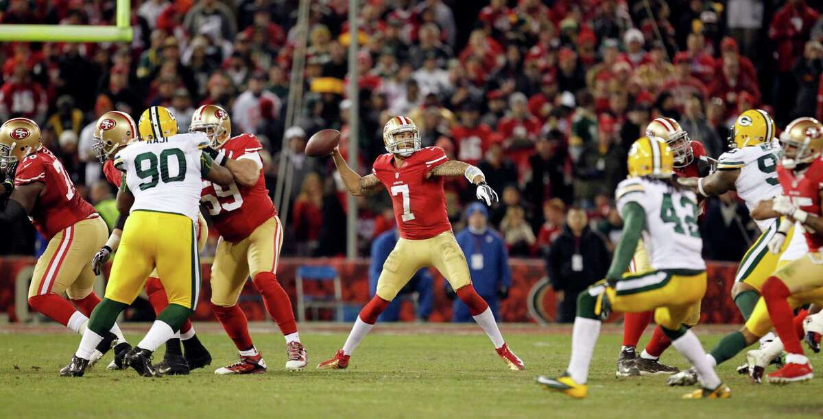 San Francisco 49ers quarterback Colin Kaepernick (7) passes against the Green Bay Packers during the third quarter of an NFC divisional playoff NFL football game in San Francisco, Saturday, Jan. 12, 2013. (AP Photo/Tony Avelar)