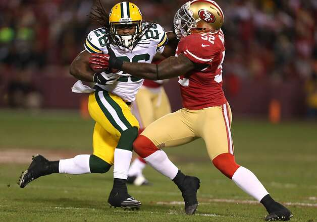 Niners linebacker Patrick Willis tackles running back DuJuan Harris in the first quarter, when the Packers scored 14 points. Photo: Micheal Macor, The Chronicle