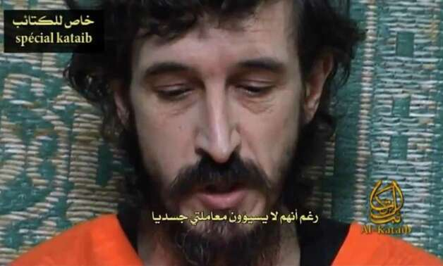 A video posted on Islamic militant websites  Wednesday show a man identified as French security agent Denis Allex pleading for his release from the Somali militant group al-Shabaab, who have been holding him for nearly a year. A French commando raid in Somalia to free a captive intelligence agent ended in the deaths of 17 Islamists and a French soldier. France said the hostage also died in the failed rescue, but the man's captors denied he had been killed and claimed Saturday to have seized a second soldier. Photo: AP