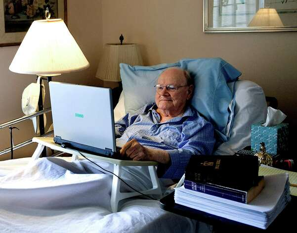 Gene Patterson, former chairman and chief executive of the Times Publishing Company and its affiliates, checks his email from his bed in St. Petersburg, Fla, in August. Patterson edited 600,000 words out of the King James Bible shown at right, sitting on top of his finished manuscript. Newspaper editor and columnist Eugene Patterson, who helped fellow Southern whites understand the civil rights movement. He died Saturday at 89.  (AP Photo/The Tampa Bay Times, Cherie Diez) Photo: AP