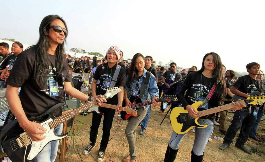 Participants play the electric guitars in an attempt to create a Guinness record for the largest electric guitar ensemble, in Dimapur, in the northeastern Indian state of Nagaland on Saturday. With a total of 368 participants, the group created a new Guinness record, according to officials. Photo: AP