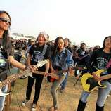 Participants play the electric guitars in an attempt to create a Guinness record for the largest electric guitar ensemble, in Dimapur, in the northeastern Indian state of Nagaland on Saturday. With a total of 368 participants, the group created a new Guinness record, according to officials.