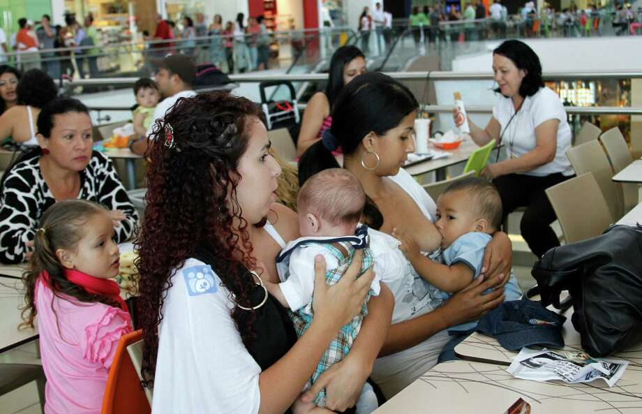 Costa Rican women breast feed their babies during a pro-breastfeeding demonstration at the Plaza Lincoln shopping center in San Jose, Costa Rica, on Saturday. At least 50 mothers gathered in the mall's fast food area and breastfed infants for nearly two hours Saturday, protesting over the shopping center forcing a woman to stop nursing her daughter a week earlier. Photo: AP