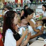 Costa Rican women breast feed their babies during a pro-breastfeeding demonstration at the Plaza Lincoln shopping center in San Jose, Costa Rica, on Saturday. At least 50 mothers gathered in the mall's fast food area and breastfed infants for nearly two hours Saturday, protesting over the shopping center forcing a woman to stop nursing her daughter a week earlier.