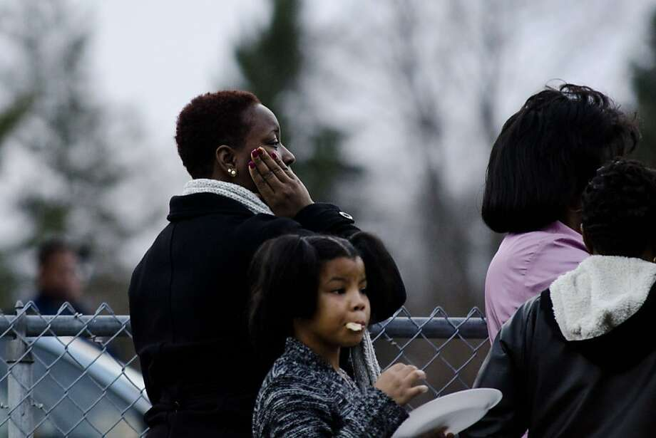 After being questioned by officers, people leave the Full Gospel Christian Church on Martin Luther King Avenue in Flint, Mich. on Saturday, Jan. 12, 2013 after a man was shot inside during the funeral of Gerrell Tyler, 26, who was shot to death in Flint on Dec. 30. Police said the suspect fled the scene and is still at large. Photo: Lauren Justice, Associated Press