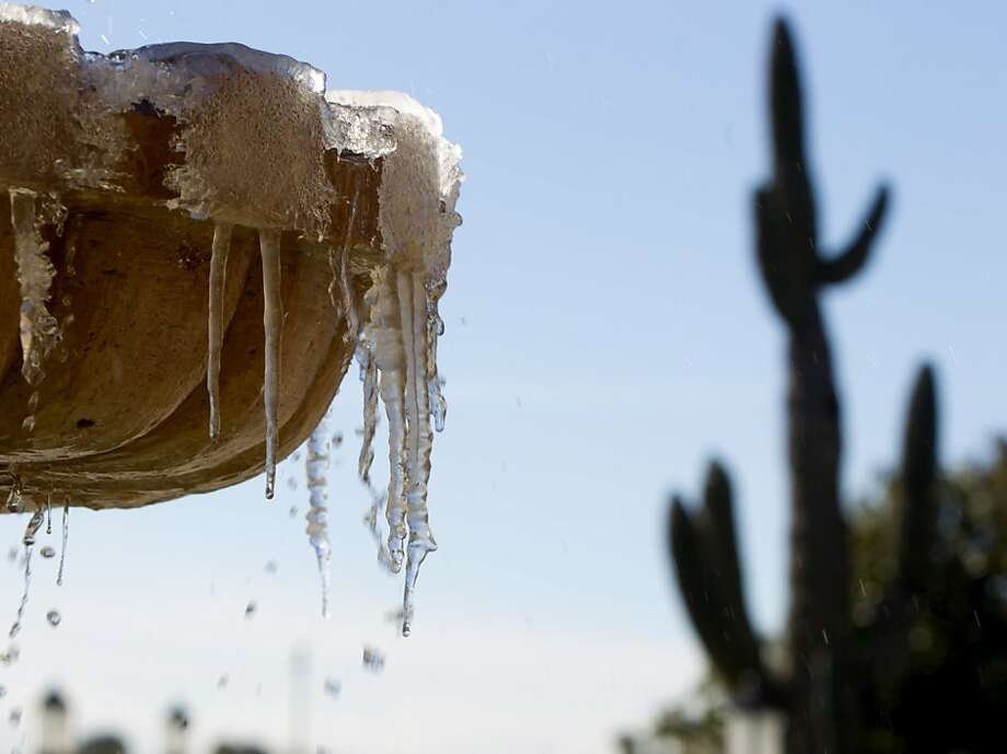 Freezing temperatures create icicles on on a water fountain at the Scottsdale Plaza Resort, Saturday, Jan. 12, 2013, in Scottsdale, Ariz. Photo: Cheryl Evans, Associated Press