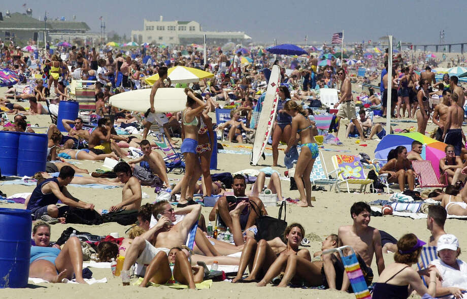Visitors and residents spend the day on the beach in Belmar, N.J., on this first  day of summer. (Associated Press)