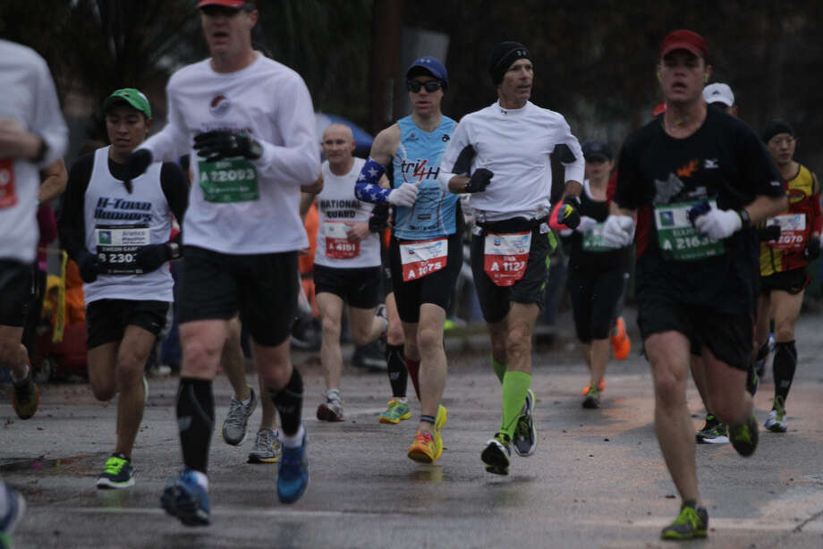 Runners pass along on Studewood near White Oak during the Chevron Houston Marathon and Aramco Houston Half Marathon.
