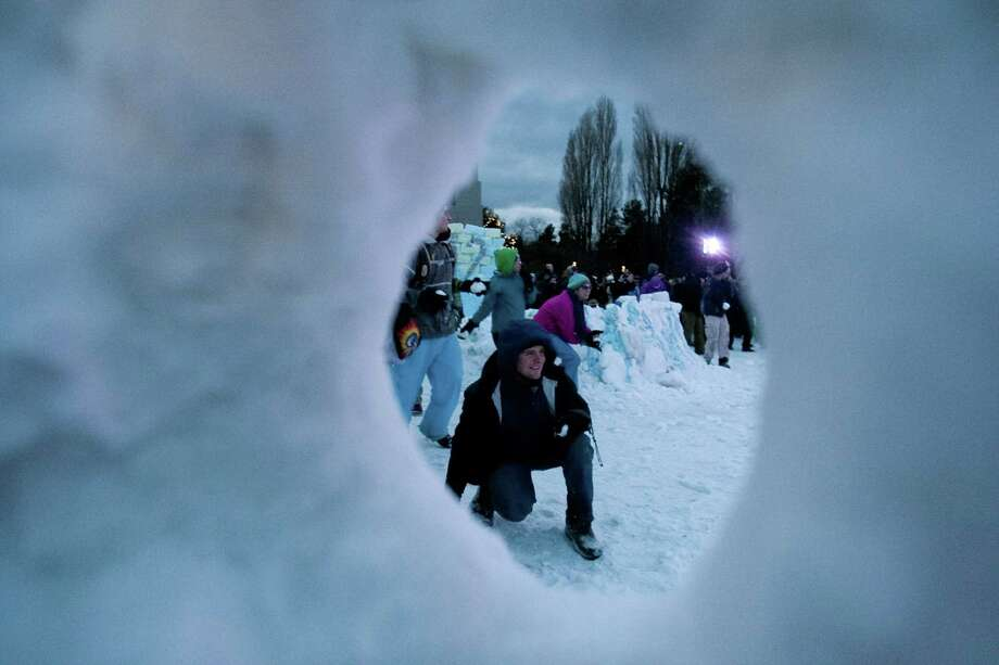 "People participate in ""Snow Day,"" a Guinness World Record-breaking snowball fight at the Seattle Center. Photo: JOSHUA TRUJILLO, SEATTLEPI.COM / SEATTLEPI.COM"