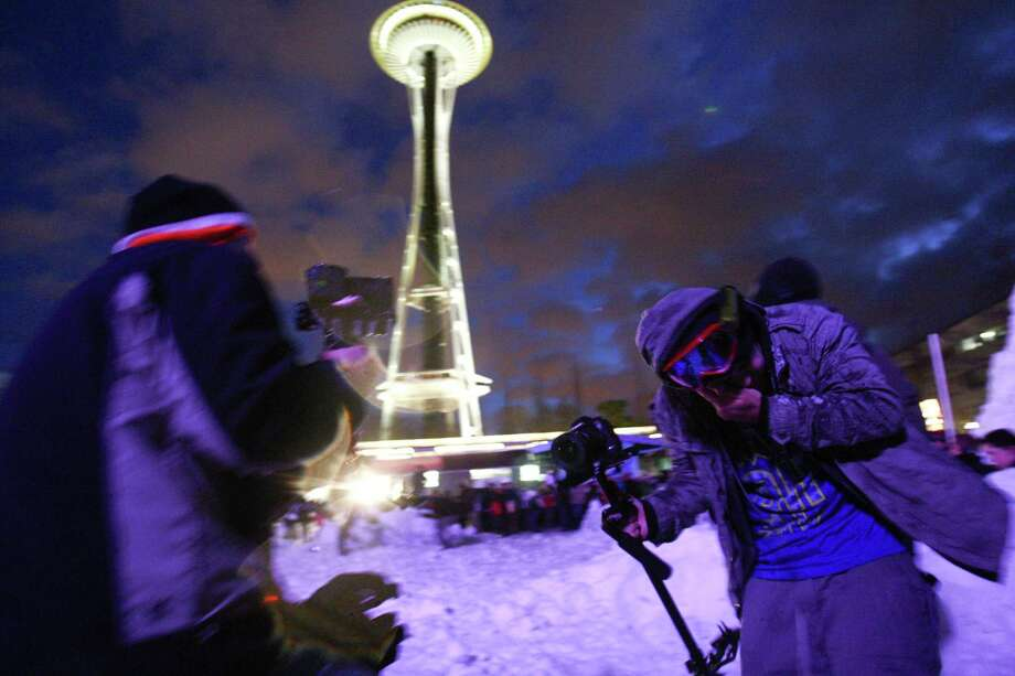 "Popular Internet cinematographer Devin ""Super Tramp"" Graham takes a direct hit during ""Snow Day,"" a Guinness World Record-breaking snowball fight at the Seattle Center. The snow was trucked in from the Cascade mountains for the event. Photo: JOSHUA TRUJILLO, SEATTLEPI.COM / SEATTLEPI.COM"