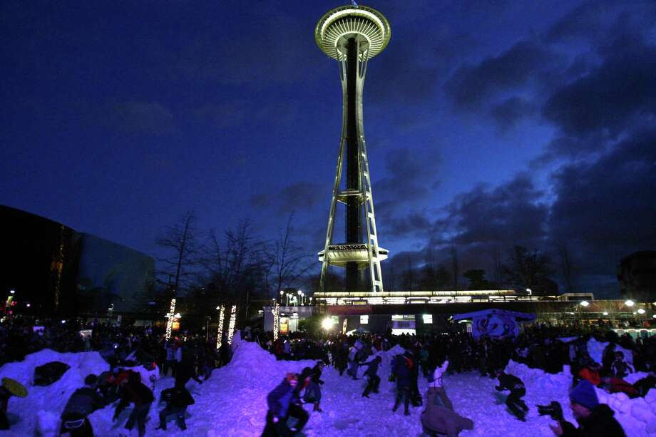"""People participate in """"Snow Day,"""" a Guinness World Record-breaking snowball fight at the Seattle Center. Photo: JOSHUA TRUJILLO, SEATTLEPI.COM / SEATTLEPI.COM"""