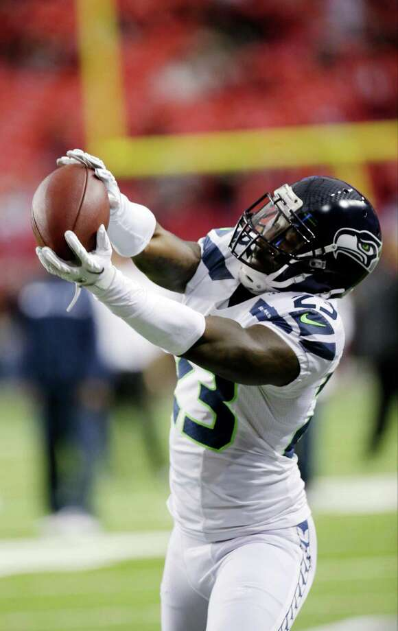 Seattle Seahawks' Marcus Trufant catches a ball before the first half of an NFC divisional playoff NFL football game against the Atlanta Falcons Sunday, Jan. 13, 2013, in Atlanta. Photo: AP