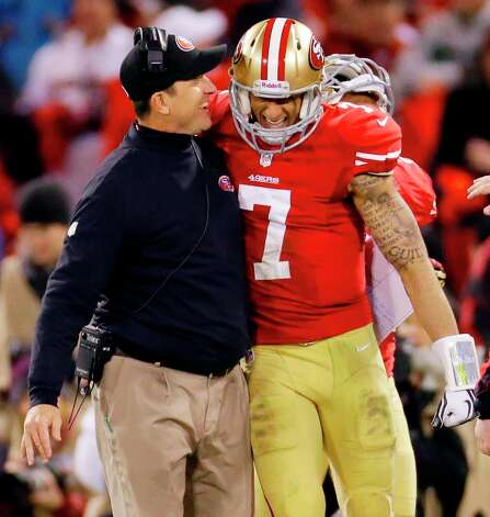 San Francisco 49ers head coach Jim Harbaugh celebrates with quarterback Colin Kaepernick (7) after Kaepernick's 56-yard touchdown run against the Green Bay Packers during the third quarter of an NFC divisional playoff NFL football game in San Francisco, Saturday, Jan. 12, 2013. (AP Photo/Ben Margot) Photo: Ben Margot, Associated Press / AP