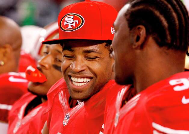 Michael Crabtree (center) laughed with Aldon Smith (right) on the bench as the game wound down. The San Francisco 49ers beat the Green Bay Packers 45-31 at Candlestick Park Saturday January 12, 2013. Photo: Brant Ward, The Chronicle / ONLINE_YES