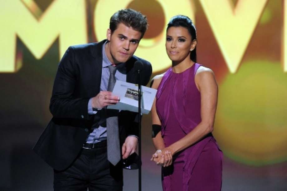 SANTA MONICA, CA - JANUARY 10:   (L-R) Presenters Paul Wesley and Eva Longoria onstage at the 18th Annual Critics' Choice Movie Awards held at Barker Hangar on January 10, 2013 in Santa Monica, California. Photo: Getty Images