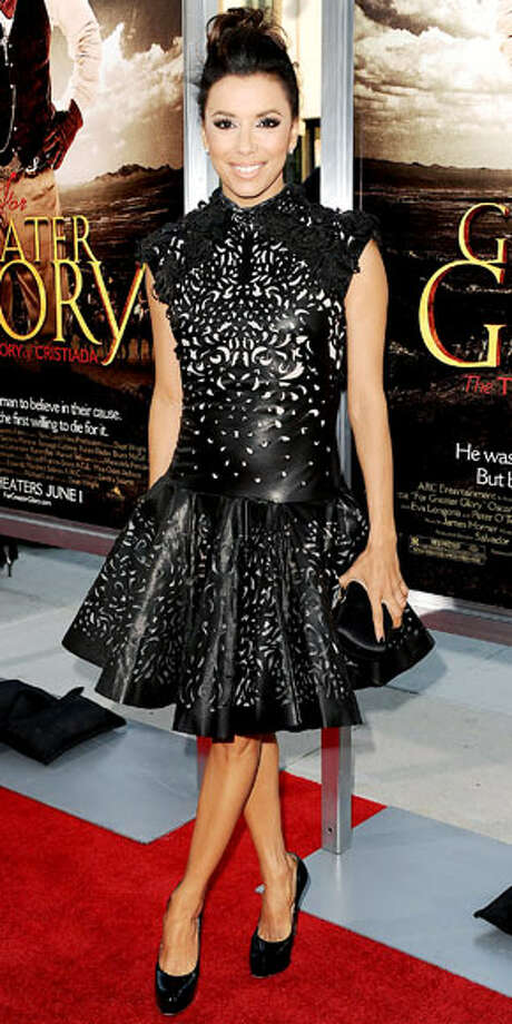Eva Longoria shows off a cocktail length black Marchesa dress at the L.A. premiere of her movie 'Greater Glory.' Photo: Jason LaVeris