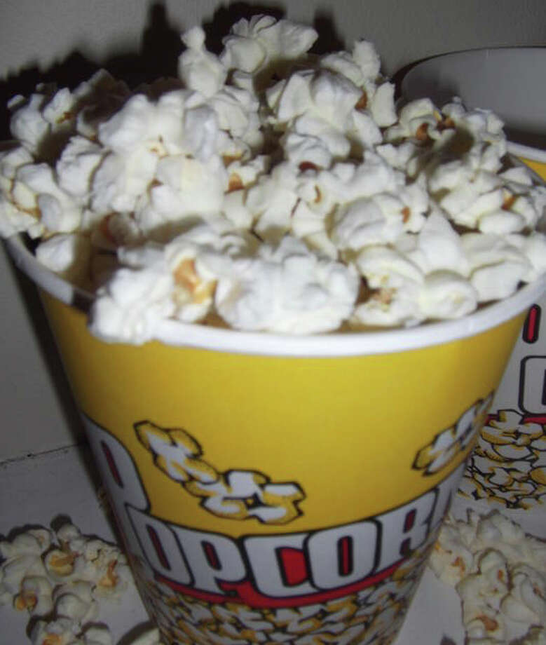 ... an ounce of low-fat microwaved popped popcorn (120 calories). Photo: Patti Woods / Fairfield Citizen contributed