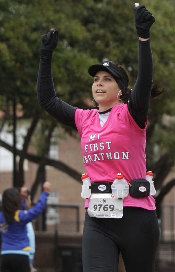 Abi Merkle Runs along University near mile 13 of the Chevron Houston Marathon.