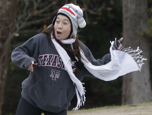 Ashley White cheers on runners along Allen Parkway near mile 24 of the Chevron Houston Marathon.